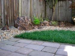 Here is another view of the patio facing another small lawn and a bioswale to manage storm runoff.