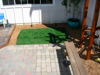 Here is a cobblestone patio installed with a small lawn in Santa Rosa.